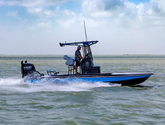man-driving-fishing-boat